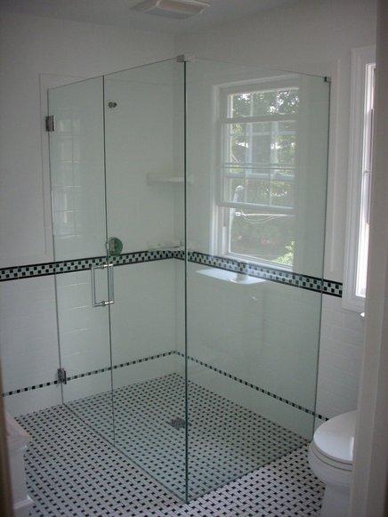 Frameless shower doors spartan glass mirror llc for Faience salle de bain tunisie